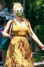Busy Philipps Looks radiant in yellow while visiting a friend in Los Feliz