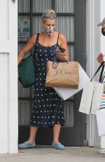 Busy Philipps Wears a blue polka dot dress as she picks up new clothes at her stylists