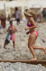 Caprice Bourret Photographed taking a dip in the sea at the Casa Jondal in Ibiza
