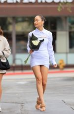 Cara Santana Stuns in an all-white outfit while buying flowers at Bristol Farms with a friend in Los Angeles