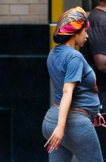 Cardi B Shows off her growing baby bump as she shops on Fifth Ave in casual sweats and slides in New York