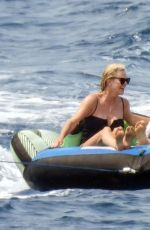 Charlize Theron Enjoys a boat trip with her daughters in Greece