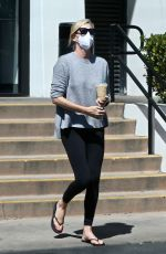 Charlize Theron Makes a quick stop at her local Starbucks to grab an iced coffee drink in West Hollywood