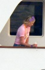 Charlize Theron Poses for a photo on aboard a yacht on her 46th birthday in Mykonos