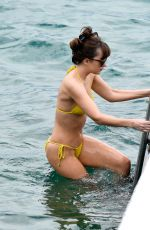 Dakota Johnson Wearing a yellow bikini and get topless on the set of Fifty Shades Darker in France