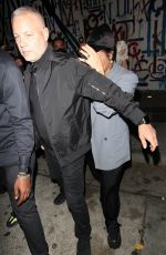 Demi Lovato And a mystery woman attempt to escape the flash frenzy of the paparazzi as they leave dinner at Craig