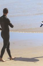 Elsa Pataky Hits the beach for a morning surf and some exercise amid the regional Covid lockdown in NSW, Australia