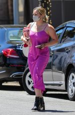 Hilary Duff Wears a hot pink dress paired with black booties while out running errands in Beverly Hills