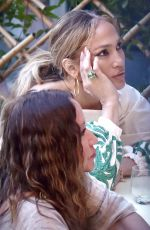 Jennifer Lopez Enjoying a meal and wine with friends at Ristorante Puny while vacationing in Portofino