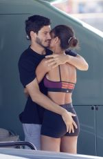 Joan Smalls And her boyfriend Henry Junior Chalhoub mix sports and cuddles while lounging on their boat in the port of Saint-Tropez