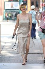 Kaley Cuoco Wears a silver slip dress on the set of
