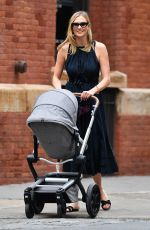 Karlie Kloss Takes baby Levi for a stroll in New York