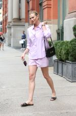 Karlie Kloss Wears a purple jacket and shorts in New York