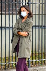 Katie Holmes Keeps a low profile while out for a morning walk in the East Village