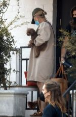 Katy Perry Carries her dog while out for a pampering session at a skincare clinic in Beverly Hills