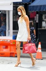 Kelly Bensimon Flashes a peace sign and flaunts her tan-toned legs while out in SoHo, New York