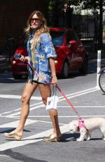 Kelly Bensimon Shows her long legs during a hot summer day while kissing her dog Fluffy in Manhattan's Soho area