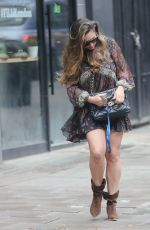 Kelly Brook Makes a leggy appearance at Heart radio wearing a paisley minidress and suede boots in London
