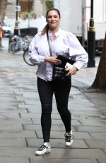 Kelly Brook Steps out in a white blouse and tight fit trousers at Heart Radio in London