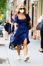Kelly Ripa In a blue dress while walking in New York