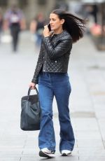 Kirsty Gallacher Looks chic in tight denim bell bottomed trousers and leather jacket at Smooth Radio in London