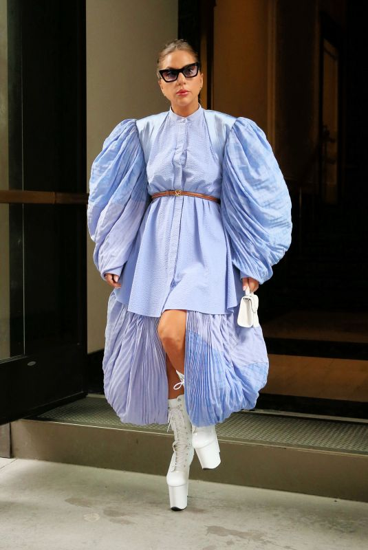 Lady Gaga Stuns in a blue dress with puffy sleeves and lace-up white platform boots in New York