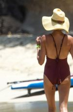 Lauren Silverman Shows off her physique and stunned in a burgundy-colored swimsuit out on holiday in Barbados