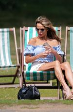 Lizzie Cundy Out in Hyde Park enjoying the good weather whilst sunbathing and taking a spin on the water in a pedal boat in London