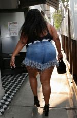 Lizzo Proudly shows of her curvy figure at Craigs in West Hollywood