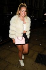 Lucinda Strafford Puts on a leggy display in little leather shorts as she heads to Rosso Restaurant in Manchester