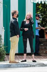 Melanie Griffith Gets flirty with a mystery man in West Hollywood