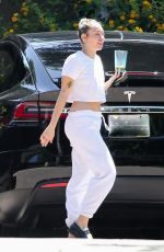 Miley Cyrus Keeps it simple and comfy wearing sweat pants and a white crop top while visiting friends in Malibu