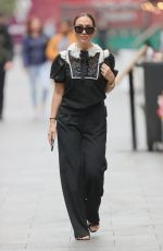 Myleene Klass Looks sensational in a sparkling monochrome top and black trousers as she struts outside Smooth radio in London
