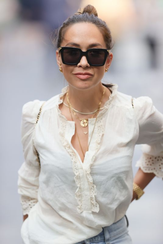 Myleene Klass Looks weekend ready rocking casual chic in white blouse and flared denim at Smooth radio in London