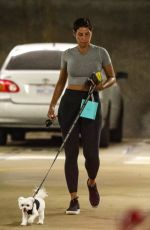 Nicole Murphy Exchanges a gift with her dog at Tiffany & Co