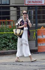Olivia Palermo Looks edgy in a sheer summer skirt paired with a bomber jacket while out in New York