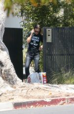 Olivia Wilde Picks up a package outside her house in Los Angeles