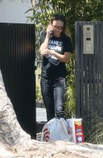 Olivia Wilde Takes a phone call as she picks up her mobile order from Target outside of her home in Los Angeles