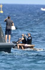 Paris Hilton Enjoys a puff on an electronic device as she is seen enjoying an afternoon out with fiance Carter Reum ib Sardinia