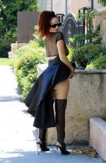 Phoebe Price In a black outfit with a long skirt posing for the cameras enjoying a Fanta on Monday in Los Angeles