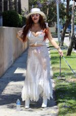 Phoebe Price Poses and accidentally spills water on herself during a Tuesday out in Los Angeles