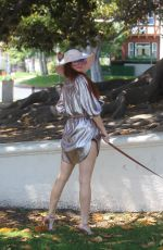 Phoebe Price Poses for pictures with her pooch in a park in Beverly Hills