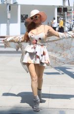 Phoebe Price Stops to pose for pictures while shopping in Beverly Hills
