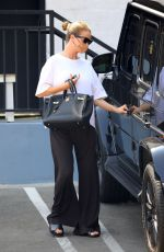 Rosie Huntington-Whiteley Steps out in a casual monochrome outfit to run a few errands in Beverly Hills