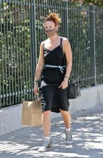 Rumer Willis Cuts a casual figure in a black dress while out picking up some lunch to go in Los Feliz