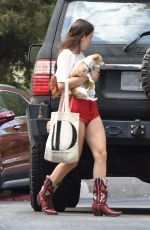 Scout Willis Rocks red shorts and matching cowboy boots as she heads to sister Talulah