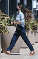 Scout Willis Waves her long locks whole wearing an all-blue ensemble in Los Angeles