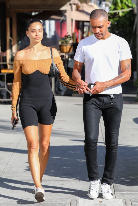 Shanina Shaik And her boyfriend Matthew Adesuyan share a loving kiss and embrace while out to dinner at IL Pastaio in Beverly Hills
