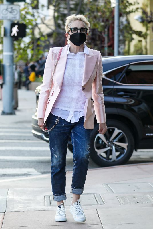 Sharon Stone In a pink blazer and matching pink purse while meeting a friend for dinner and wine at Toscana Restaurant in Brentwood