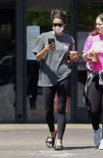 Shay Mitchell Goes out with a friend for an iced coffee drink on a hot day in Los Feliz